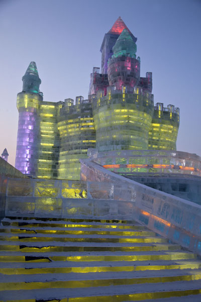 Stairs leading to one of the fairy tale ice castles at sunset | Ice and Snow World | China