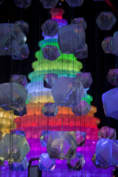 Blocks of ice dangling in the air with Christmas tree in the background | Ice and Snow World | China