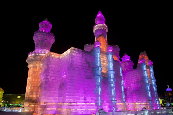 One of the fairy tale castles made of ice in the evening | Ice and Snow World | China