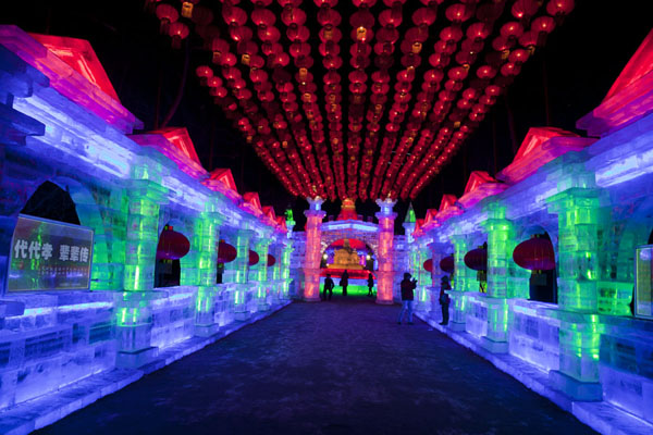 Picture of Ice Lantern Art Show (China): Walls of ice with a roof of orange lanterns: the entrance to the exhibition