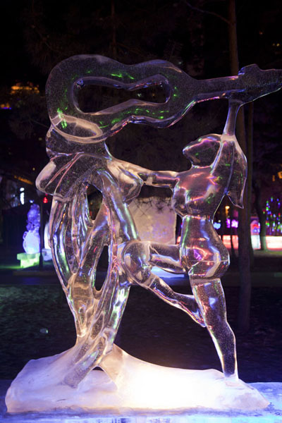 Ice sculpture of woman with instrument | Ice Lantern Art Show | China