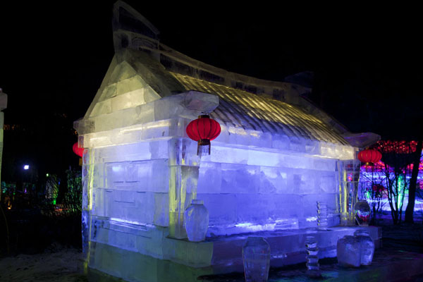 Picture of Transparent ice blocks in a traditional temple with orange lanterns