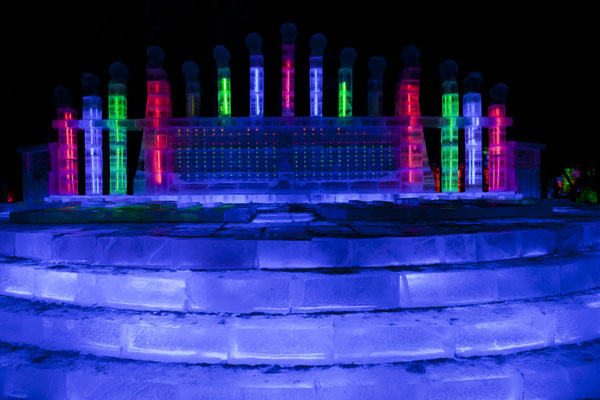 Picture of Ice Lantern Art Show (China): Colourful pillars on top of a platform of ice