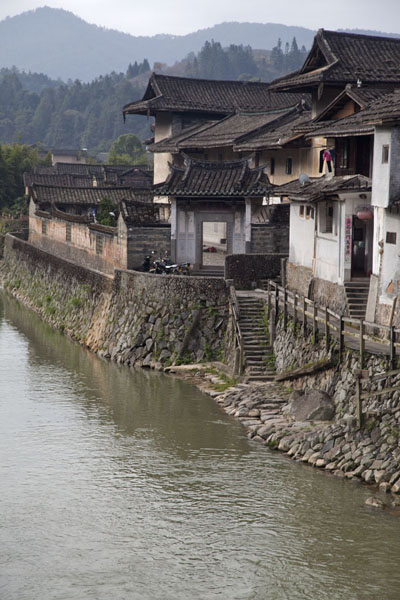 Side view of Fuyu Lou, large tulou complex on the riverfront | Hongkeng Tulou Cluster | China