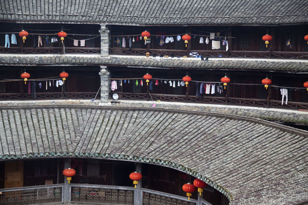 Picture of Hongkeng Tulou Cluster (China): Floors decorated with red lanterns in Zhencheng Lou, the largest tulou of the Hongkeng cluster