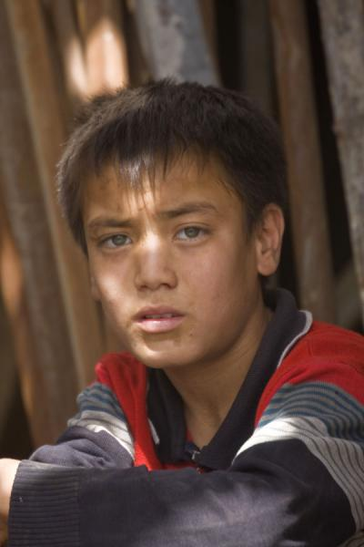 Picture of Uyghur boy with clear eyes at the market of Hotan