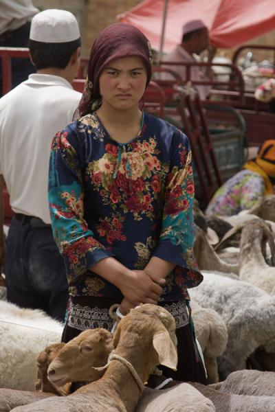 Uyghur woman with sheep at the market of Hotan | Hotan Bazaar | China