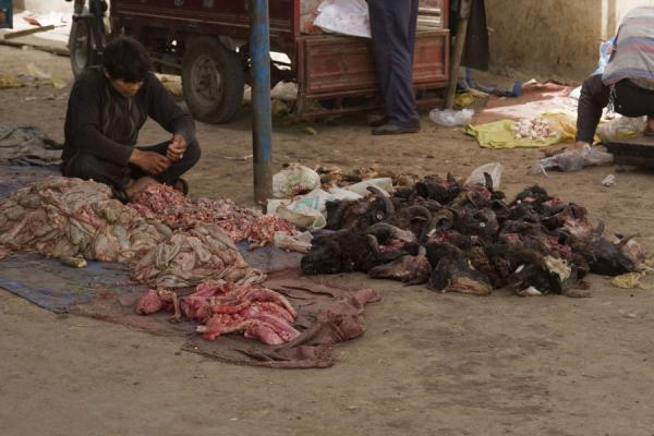 Uyghur separating parts of slaughtered animals | Hotan Bazaar | China