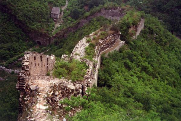 Crumbling Great Chinese Wall running down a hill | Huanghua Great Wall of China | China