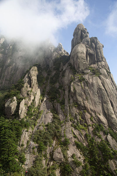 Looking up Celestial Peak, with a long stair-path leading up to its top | Huangshan Mountains | China