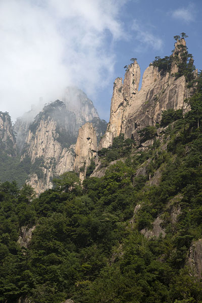 Looking up rock formations in the clouds from the West Sea Canyon | Huangshan Mountains | China