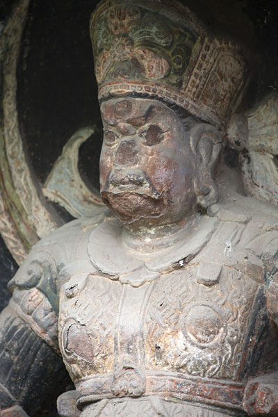 Foto van Close-up of a deity in a niche in the cliffJiajiang - China