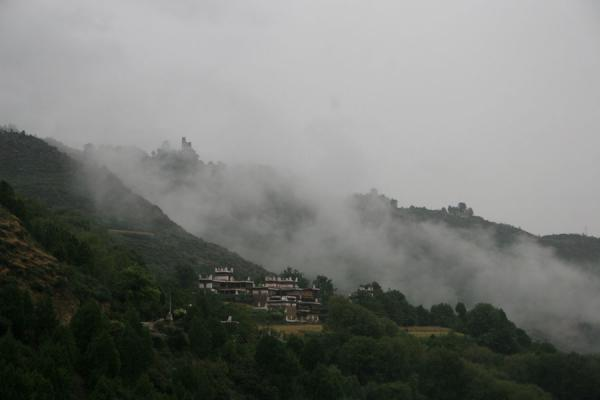 Fog climbing up the mountain of Jiaju village | Jiaju Tibetan village | China