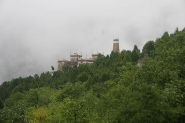 Picture of Jiaju Tibetan village (China): Tibetan house and watchtower seen from a distance in Jiaju