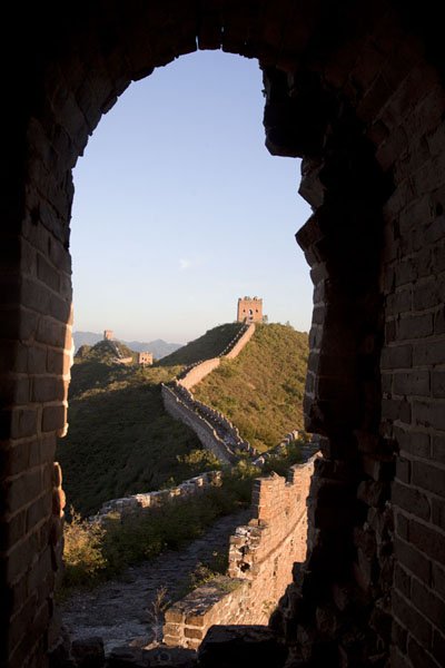 Early morning view of the Great Wall through an opening in one of the many watchtowers | Jinshanling Great Wall | China