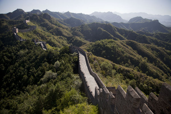 Picture of The Great Wall meandering over the hills of Jinshanling, looking east