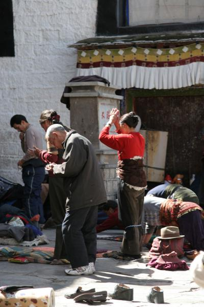Tibetans praying in front of Jokhang temple | Jokhang temple | China
