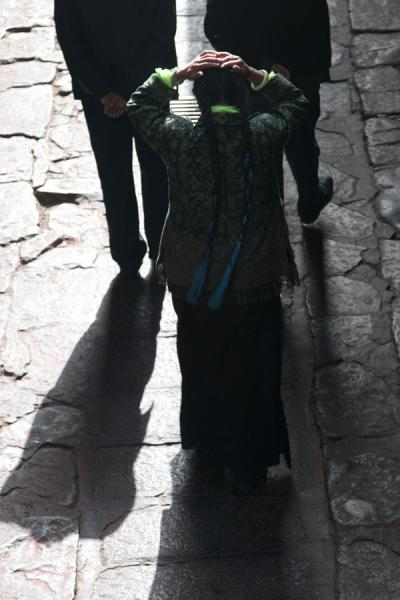 Picture of Jokhang temple (China): Blue and black braids on Tibetan woman at Jokhang temple