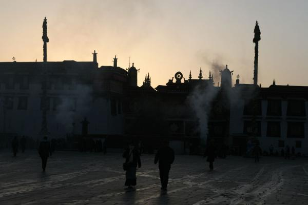 Jokhang temple at sunrise with smoke from burning juniper branches | Jokhang temple | China