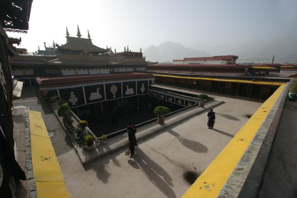Tibetans on roof of Jokhang with silhouette of the temple | Jokhang temple | China