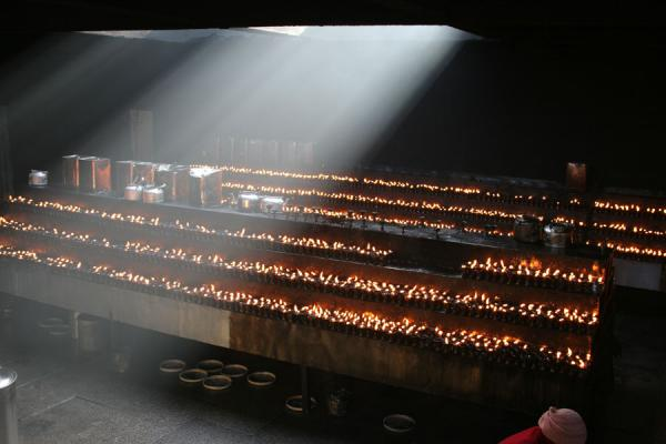 Hundreds of burning yak butter lamps | Jokhang temple | China