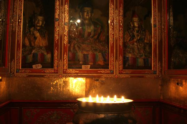 Picture of Jokhang temple (China): Yak butter candles burning in one of the chapels of Jokhang temple