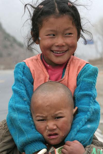 Sister and brother posing outside Jyekundo town | Jyekundo faces | China