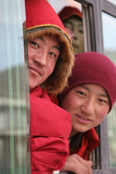 Monks in a bus to Trangu monastery | Jyekundo faces | China