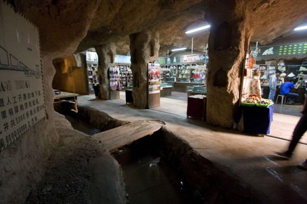 A karez visible for visitors and shop right next to it | Karez | China
