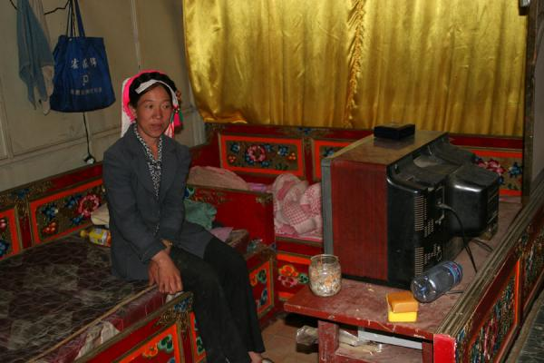Khampa woman watching TV | Khampa Tibetans | China