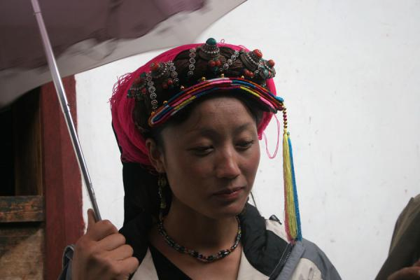 Young Khampa woman with traditional jewellery and umbrella | Khampa Tibetans | China