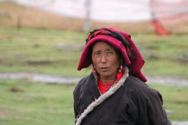 Old Khampa woman in the countryside, braving the elements | Khampa Tibetans | China
