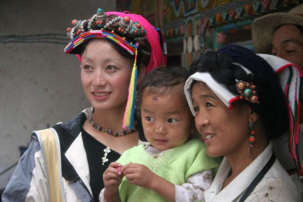 Family in traditional Tibetan village | Khampa Tibetans | China