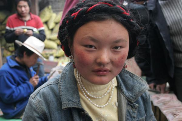 Tibetan girl working in workshop at Tagong monastery | Khampa Tibetans | China