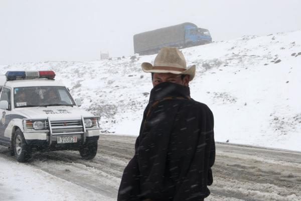 Picture of Tibetan walking in the snow with cowboy hat