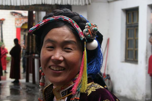 Traditionally dressed Tibetan woman in a temple in Kangding | Khampa Tibetans | China