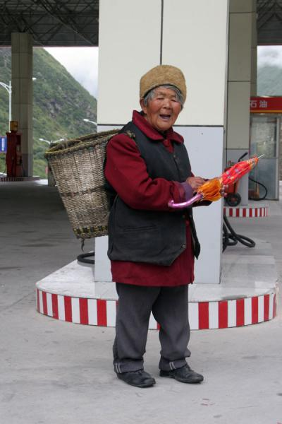 Picture of Khampa Tibetans (China): Old Tibetan woman in gas station
