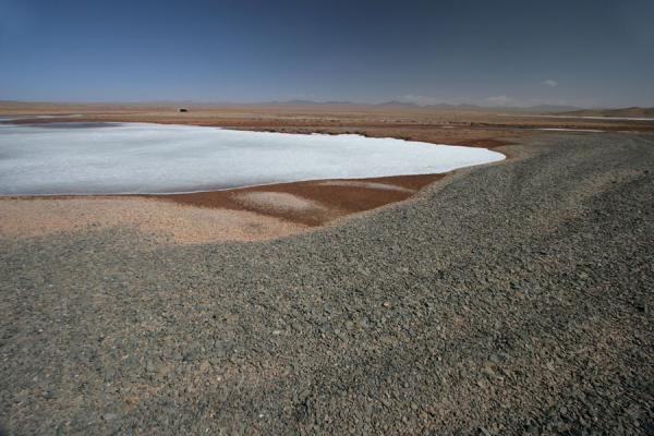 Ice in a barren landscape at the shore of Ngoring Tso | Ngoring Lake | China