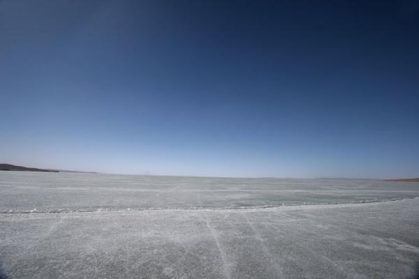 The ice surface stretches as far as the eye can see | Ngoring Lake | China