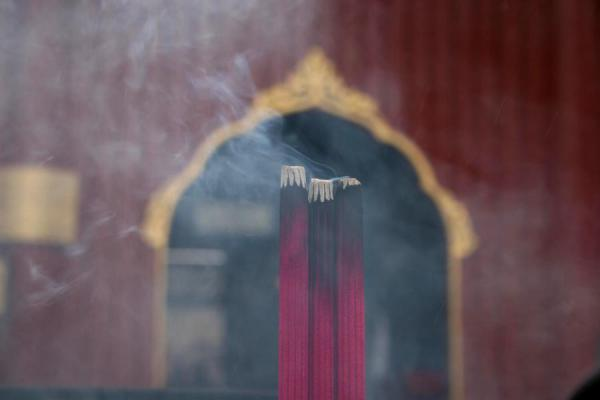 Incense burning at one of the many burners outside a temple | Lama Temple | China