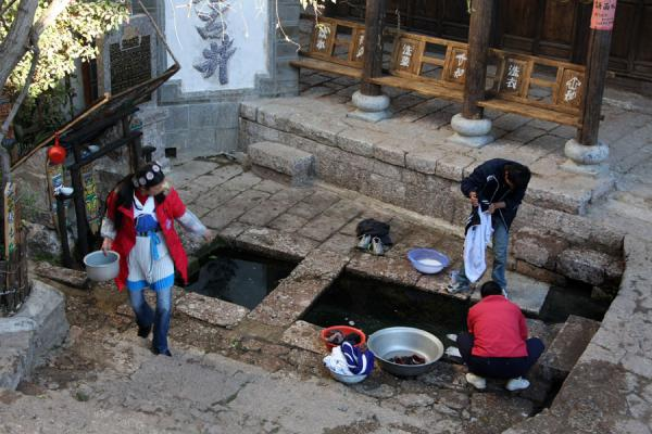 Using one of the many wells of Lijiang | Lijiang Old Town | China