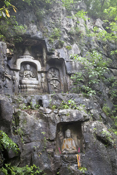 Picture of Lingyin temple complex (China): Several Buddha statues in caves at the foot of Feilai Feng mountain at Lingyin