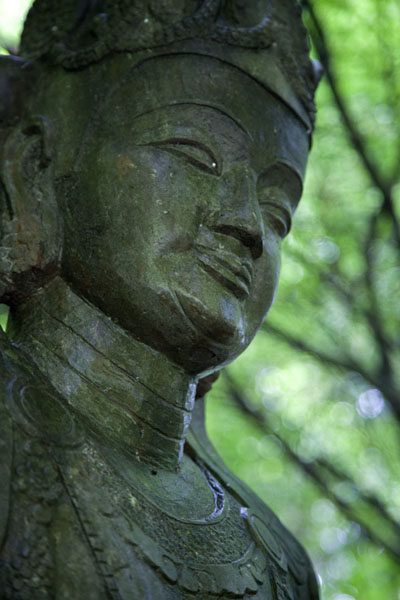 Picture of Lingyin temple complex (China): Face of Buddha statue at the foot of Feilai Feng