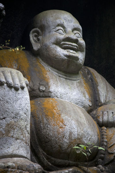 Picture of Lingyin temple complex (China): Laughing Buddha sculpture inside a cave of Lingyin