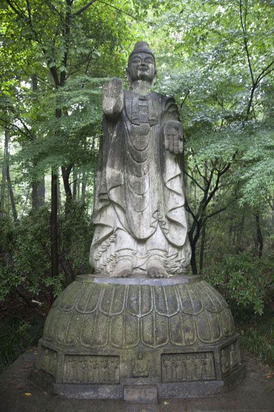 Picture of Lingyin temple complex (China): One of the many Buddhist statues in the park at Lingyin complex