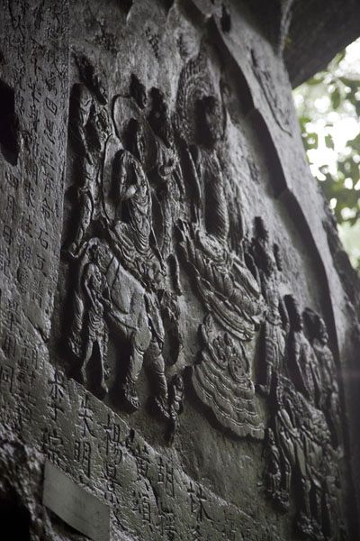 Picture of Buddhist scene sculpted on the face of a rock inside a cave at Lingyin