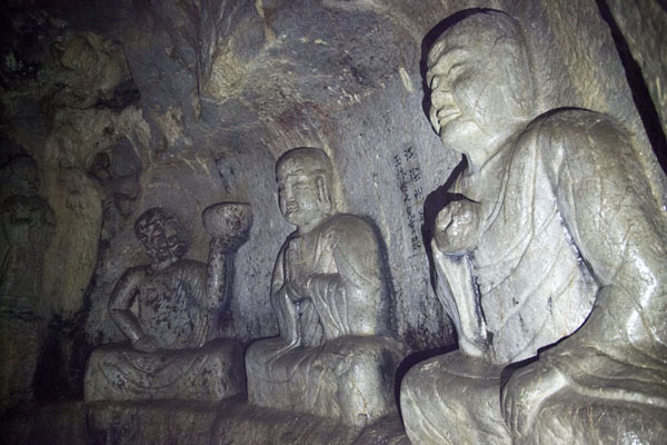 Picture of Buddhas sculpted out of the rock wall inside a cave at Lingyin