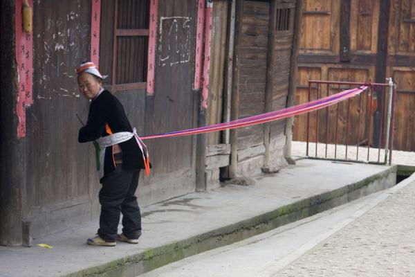 Picture of Matang Village (China): Gejia woman working on traditional clothes
