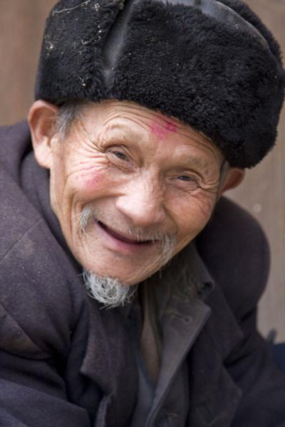 Picture of Matang Village (China): Friendly old inhabitant of Matang