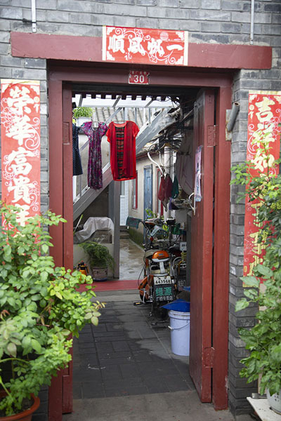 Foto van Peeking into one of the courtyards of a typical houseBeijing - China
